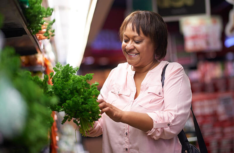 Woman shopping for healthy food in a grocery store